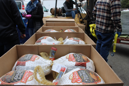 Handing out turkeys from the 2015 Challenge